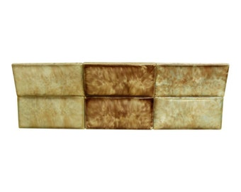 Set of twelve decorative ceramic tiles