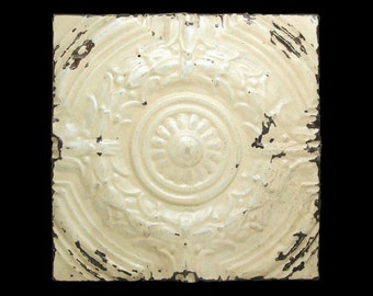 Cream colored floral tin panel