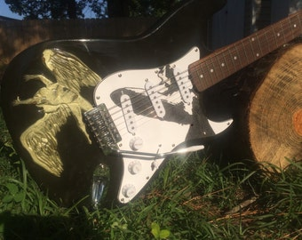 Hand Carved Icarus/Hindenburg six string Guitar