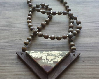 Beaded wooden geometric necklace with gold leaf