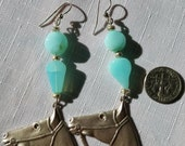 Horse heads in silver tone with sterling French ear wire and Peruvian blue opal beads