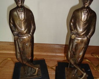 2 Vintage Bronze Cast Lamps of A 1920's Style  Golfer in working condition with wonderful well developed  patina which need lampshades