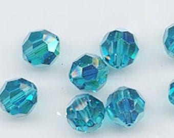 "Twelve ""out of program""  Swarovski crystals - Art. 5000 - 8 mm - indicolite AB"