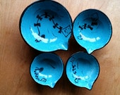 Ceramic measuring cup set of four,with whimsical autumn design a gift for your cook or baker.
