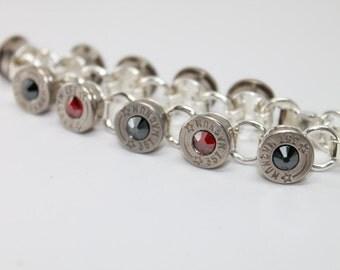 357 silver Bullet Bracelet . Ruby and Onyx Swarovski Crystals . 9mm Luger