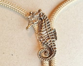 vintage sweet beige cotton cord bolo tie with silver tone seahorse slide