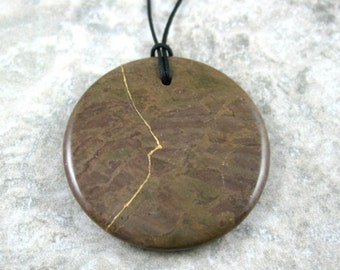 Kintsugi (kintsukuroi) rainbow jasper stone circle pendant with gold repair on black cotton cord - OOAK