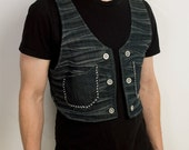 Distressed post apocalyptic holster style vest from black denim with hand stitched detailing