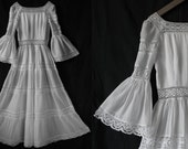 Vintage 1970's White dress, long sleeves, with trim crochet .Very Small Size