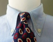 Vintage Brooks Brothers All Silk Multicolored Abstract Medallion Pattern on Navy Blue Trad / Ivy League Neck Tie.  Made in USA.