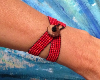 Wrap bracelet, stretchy. Choose red or blue. Glass beads.