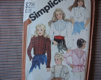 vintage 1980s Simplicity sewing pattern 5627 UNCUT  girls set of blouses size 14