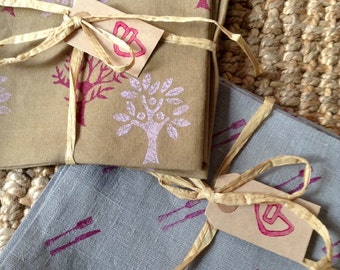 Linen napkins set of 4 hand block printed in khaki colour with two trees design in aubergine/Pink.