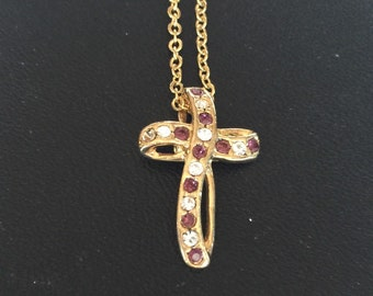 Gold cross with purple and clear stones