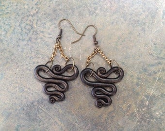 Black and gold clay earrings