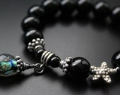 RESERVED for Lynn - Onyx and Basha bead charm bracelet starfish bracelet Bali sterling stretch stacking bracelet boho sea life beach lovers