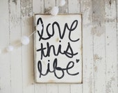 Love this life black and white rustic wood sign