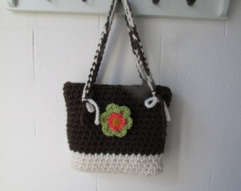 Crochet bag with removable flower brooch