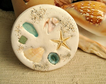 Absorbent clay coasters with natural shells. Absorbs drips from your glass. Heavy and durable coasters for your beach home decor.