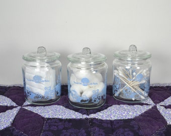 Glass Nursery Storage Jars w Lids, Set of 3 Round the Clock w Baby Canisters, Three Containers w Baby Blue Graphics, Babies at Play