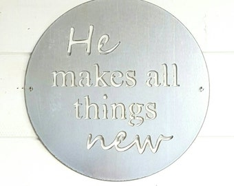 15 inch He makes all things new metal sign