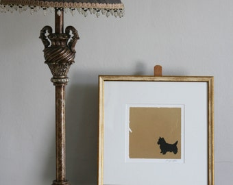 Hand painted Scottish Terrier silhouette in pen and ink on gold leaf