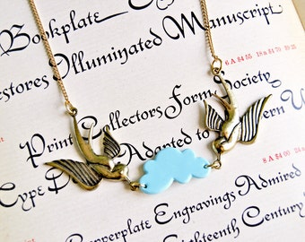 Golden tattoo style swallows and handmade polymer clay cloud necklace