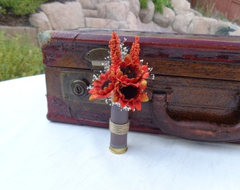 Fall sunflowers designed in a spent shotgun shell