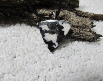 Zebra stone necklace,18 to 20 inch black suede, and sterling silver mount (box 1)