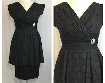 Vintage 1950's Black Peplum Dress with Cut-Out Detail