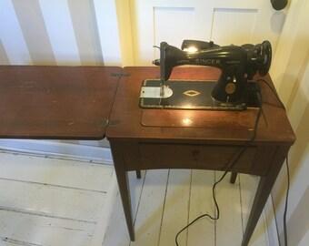 Antique Singer 15-91 straight-stitch sewing machine, 1940's