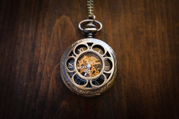 steampunk pocket watch with gears showing inner workings and