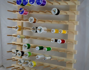 Wall display stand for 120 spools