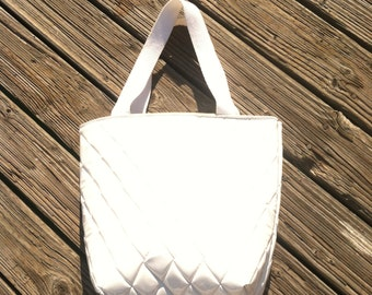 Quilted white patent vinyl tote