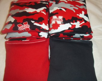 8 ACA Regulation Cornhole Bags - NCAA Nebraska Cornhuskers on Red and Black Backs