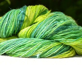 Skein of yarn spun hand green gradient
