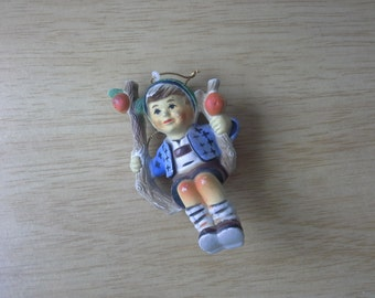 vintage plastic boy on a swing made in Hong Kong