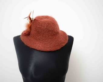 Knitted Rust Bowler Hat With Feathers