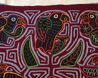 Five birds on a mola