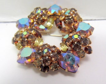 Vintage wreath brooch, covered entirely with gold, brown and autumn Aurora Borealis colored rhinestones, crystals