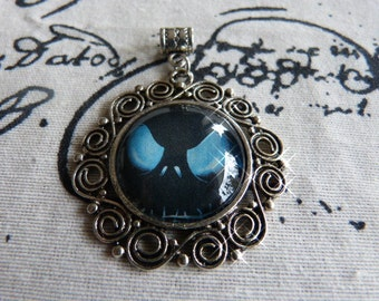 Blue Monster - pendant with motif from magazine/catalog