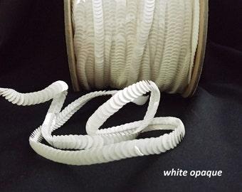 white opaque sequin trim--stretch