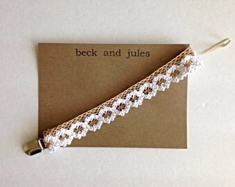Baby beige and white crochet flower binky clip
