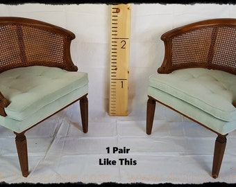 A pair of 1960's Caned Barrel Chairs