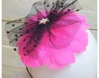 pink fascinator with feathers!