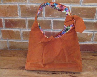Orange suede handbag