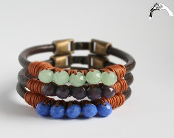 Leather bracelets with mother of pearl beads.