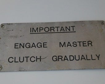 "Metal ""Master Clutch"" Sign"