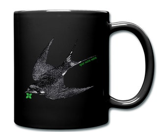 Dead Bird Swallow With Lucky Four Leaf Clover 'Que Sera Sera' Print Illustrated Ceramic Mug Cup. Black. Left Or Right Handed.