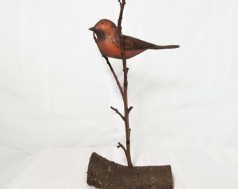 Hand carved Bird on a branch - Vintage